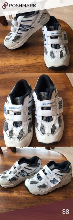 New balance white/navy blue little kids 10 These New balance shoes were only worn a few times before my son hit a growth spurt and they no longer fit. Velcro closure. Size 10 little kid New Balance Shoes Sneakers