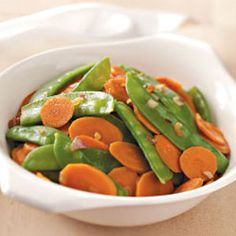 "Carrots and Snow Peas Recipe -""This is without question my favorite side dish, both for flavor and ease of preparation. Sherry adds an amazing spark to the vegetables. Cheryl Donnely - Arvada, Colorado"