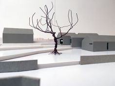 grey and white architectural model with wire tree