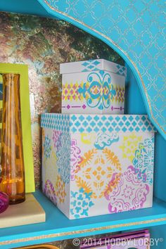 Want a nobody-else-has-it look? You can layer assorted stencils to create a unique pattern—that's how we embellished these eye-popping paper-maché boxes.