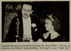 Shirley Temple presents the Oscar for Snow White and the Seven Dwarfs to Walt Disney (Photoplay, 1939-05)