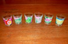 DIY Lilly shot glasses....this is definitely on my to do list! With the new Lily Pulitzer sorority fabrics this could make a cute votive holder too!