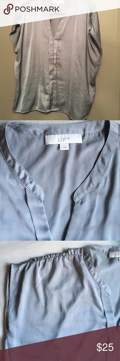 Beautiful Silky Ann Taylor Loft Blouse! This pretty blouse has only the slightest hint of sleeve & appears like silk although it is polyester. The color is gray like the last three photographs. There are buttons down the front and the shape of this blouse is boxy. Excellent condition and excellent addition to any summer work wardrobe! Ann Taylor Tops Blouses
