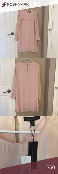Banana Republic Dress NWT - Smoke free home. Champagne color dress. Bought on sale for $79.99 without trying on and is too big for me. Rose gold color buttons, long sleeve, lined dress. Banana Republic Dresses