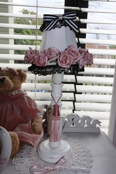 A little too frilly but if you trim the crazy pink bobbles then it would be an awfully cute my fair lady lamp.