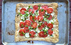 This Tomato, Basil & Zucchini Goat Cheese Tart is a simple and delicious dinner idea! It can ready and on the table in less than one hour!