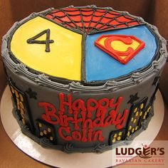Super heroes themed cake with city scape