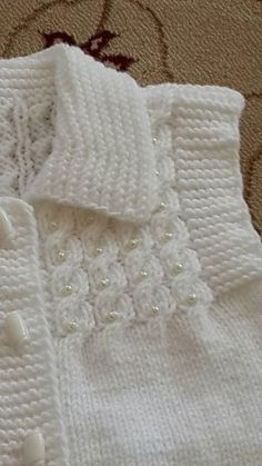 lace baby jacket knit with crochet accents from asian magazine found in russian site httpwwwliveinternetruusersbaby charts included - PIPicStats Baby Knitting Patterns, Knitting For Kids, Knitting Designs, Baby Patterns, Free Knitting, Knit Baby Sweaters, Knitted Baby Clothes, Baby Vest, Handarbeit