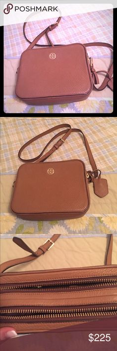 Tory Burch Robinson Double-Zip Cross-Body Tory Burch Robinson Pebbled Double-Zip Cross-Body   Excellent condition  Light brown color (tiger's eye) super-soft, richly textured leather. The clean, camera bag-inspired shape is detailed with an adjustable strap and plenty of pockets for organizing small essentials. It's polished, practical and perfect for day or evening.   DETAILS & FIT Leather. Double zipper closure. 2 zipper pockets and two open pockets. Adjustable leather cross-body strap…