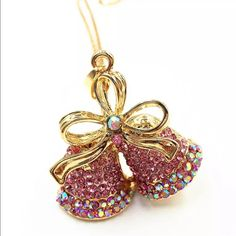 """Jingle bells crystal pendant  Jingle Bells pendant with pink and iridescent  dazzling stones. Gold alloy and comes with 27"""" chain✨✨✨New in package Jewelry Necklaces"""