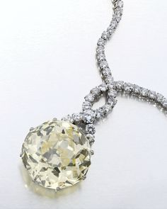 Diamond Necklace - 61.24 ct round-cut pale yellow diamond - set in necklace by Bulgari - $2.5 million at auction