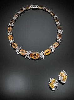 A SUITE OF CITRINE AND DIAMOND JEWELRY, BY VERDURA   Designed as a graduated line of oval-cut citrines alternating with pavé-set diamond foliate terminals; and a pair of ear clips en suite, mounted in 14K yellow gold and platinum, necklace, 15 ins.   Signed Verdura