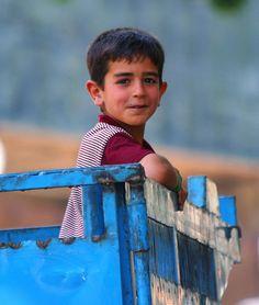 Face of an Iranian boy, smiling