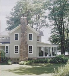 Beautiful Farmhouse!!!  Look at that amazing front porch and that GORGEOUS stone fireplace!!!  <3