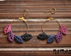 These macrame earrings were made by knotting technique and are perfect for women loving red colour. They were made on the brass hoops and are connected to the ears by the hooks.