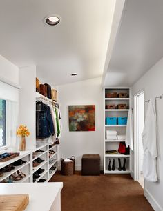 4. Set up storage. Most people can use some combination of shelves and hanging rods in the closet, so be sure you make room for both (you can always keep the shelving in your bedroom). Invest in a few sturdy baskets to keep accessories neat on shelves. Have one for each type, like belts, scarves etc. A small square ottoman takes up hardly any room and gives you a place to perch while you try on shoes.