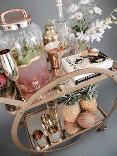 beautiful styled bar cart - love the water/juice dispenser for cocktails!