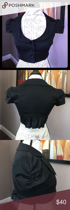 Bebe short sleeved cropped jacket Great for dressing up and covering revealing formal dresses or tops. Brand new never worn, as I was photographing noticed the tag is coming off on one side. Otherwise in perfect condition. bebe Jackets & Coats Blazers