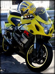 Yellow Suzuki Motorcycle near Verrazano Narrows Bridge, New York  by Julia Rozental Photography