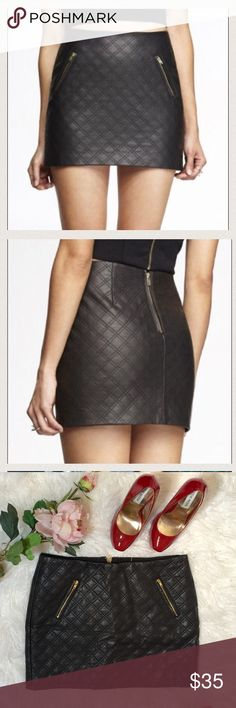 """Express Black Quilt Pattern Mini Skirt It would go with so many different tops.  You can wear something on the feminine side to soften the look of leather.  Or something that looks edgier. Flat across @ waist: 15.5"""", lenght: 14"""". NWOT Express Skirts Mini"""