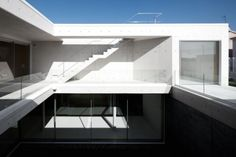 "Residential Architecture: House in Leiria by ARX: '""..the main characteristic of this house is the way its dialectical feature comes about: the underground, ""natural"" half of the building, its upper half, floating and ""artificial"", and the life flowing between the two. One face, introverted, intimate, of shadow or reflected light; another, open, glowing, transparent, from where it is possible to enjoy the distant horizon..'  Wood, concrete, glass, cent..."