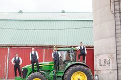 farm wedding | groomsmen photos on a tractor