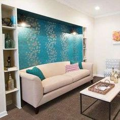 The basement of Melissa and Joe Durham Marietta's Georgia home was renovated thanks to HGTV's Property Brothers. The downstairs space features this eclectic family room with teal accent wall. Hgtv Property Brothers, Teal Accent Walls, Georgia Homes, Basement Remodeling, Basement Ideas, Decoration, Family Room, Room Decor, House Design