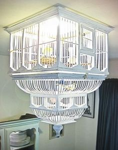 birdhouse chandelier...set of 3 hanging on chains from my veranda ceiling...yes.
