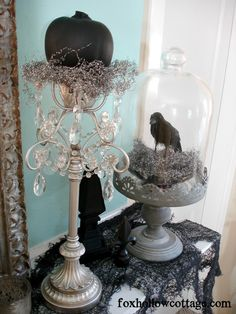 How To Get A Gothic Style Haunted Halloween Mantel - Fox Hollow Cottage Black Birds Silver Pumpkin Decor silver cake stand glass dome jar