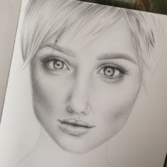 Pencil drawing of a pretty girl I saw online. Been doing more face studying of highlights and shadows