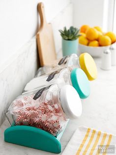 Add color to your kitchen by painting lids of canisters!