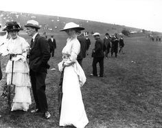 Racegoers at Goodwood Racecourse in England circa 1914 wear their finest