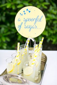 Wedding lemonade, just a spoonful of sugar sign by Eagle Eyed Bride. Floral Design & Styling by Boutique Blooms. Blue and yellow 'Let's go fly a kite' mary poppins inspired wedding theme. Photo by Anneli Marinovich Photography.     Disney's Mary Poppins theme wedding  ideas to do