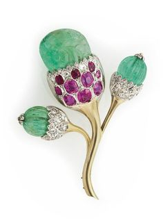A Carved Green Beryl, Pink Sapphire and White Gold Thistle Brooch. photo: Christie's Images Ltd 2012     Set with three carved green beryl, within cushion-cut pink sapphire, circular and single-cut diamond and white gold mounts, extending to the white gold stem, with French assay marks.