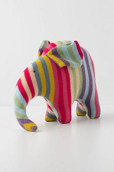 This reminds me of my favorite childhood toy. A wildly colored corded elephant from Germany, circa 1973.  Mine had a tiny wooden bird on his head!  I adore this-Confectionary Wool Elephant #anthropologie