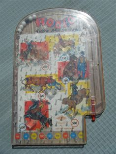 At home pin-ball. Mine was meant to be a birthday present for someone else but we missed the party and i got to keep it! It wasn't animals like this,, I don't even know the theme, I just loved playing it again, and again and again!