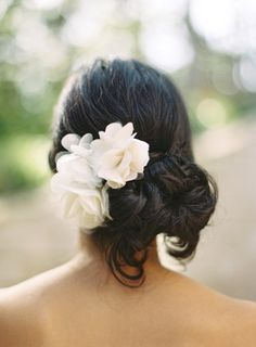 Soft, romantic, and you can show off your shoulders. Love this hairstyle + flower pairing ~ Style Me Pretty