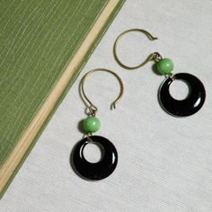 Enameled Earrings Black hoop and green bead $15