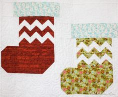 Santa's Stockings blocks in the Deck-ade the Halls Quilt by Fat Quarter Shop