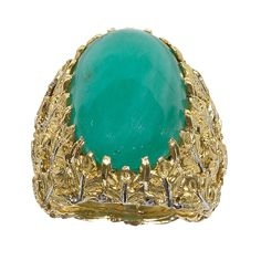BUCCELLATI Large Jadeite And Two Color Gold Ring,Centring on an oval jadeite cabochon, to a stylised leaves 18 karat white and yellow gold mount.
