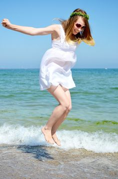 The Lovely Darlings: Loving the sea, all white, flower crown, sea, beach outfit, fairytale , blonde, ombre hair, hairstyle, floral headband, white dress, crochet, denim shorts, jump, happiness