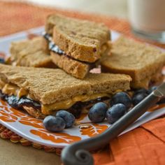 Always a crowd-pleaser, the simple PB&J on whole wheat bread offers complete protein since it's a combination of nuts and grains. Two slices of whole wheat bread (200 calories), plus one tablespoon of all-natural creamy peanut butter (105 calories), and one tablespoon of strawberry jam (40 calories) make a 345-calorie sandwich.