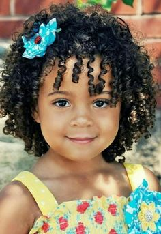 Gorgeous baby girl with Shirley Temple curls
