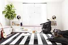 Chic black and white nursery. Get Low With These Floor Lounging Essentials, by Consort.