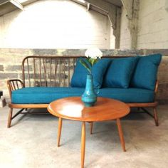 Reupholstered in teal fabric this Ercol Jubilee sofa is both stylish and comfortable. A classic mid century piece that would look great in any home. Ercol Sofa, Ercol Dining Chairs, Ercol Furniture, Blue Velvet Dining Chairs, Shabby Chic Furniture, Living Room Colors, Living Room Decor, Dining Room, Living Spaces