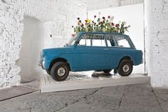 Artist Manuel Felisi trussed up a vintage Autobianchi into a massive flower vase.  Rather a large piece to put in your living room or foyer-but if you have the room, sure would be a conversation starter.