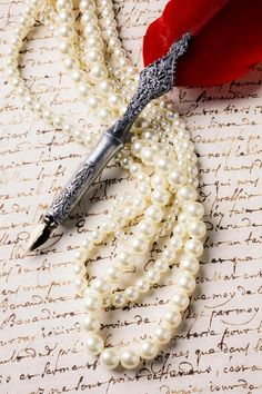 Quill and pearls