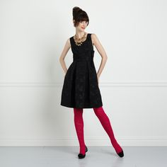 Black dress with hot pink tights from Kate Spade.