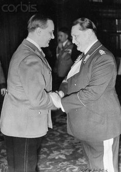 Alfred Rosenberg Shaking Hands with Hermann Goering - U430302ACME - Rights Managed - Stock Photo - Corbis. Original caption:Goering, Rosenberg Have Birthday Together. Berlin, Germany: Nazi social amenities were unusual cordial during the double birthday celebration of Reichsleader Alfred Rosenberg (left) and General Goering, Hitler's right-hand man. The two are pictured above at Goering's home in Berlin as they exchanged congratulations. Each was 45 years old. January 25, 1938