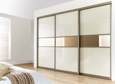 Cream high gloss sliding doors with mirror.. Visit http://capitalbedroomsandkitchens.co.uk/sliding-door-styles-configuration/ for details